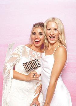 creative booth bride smiling in photo booth